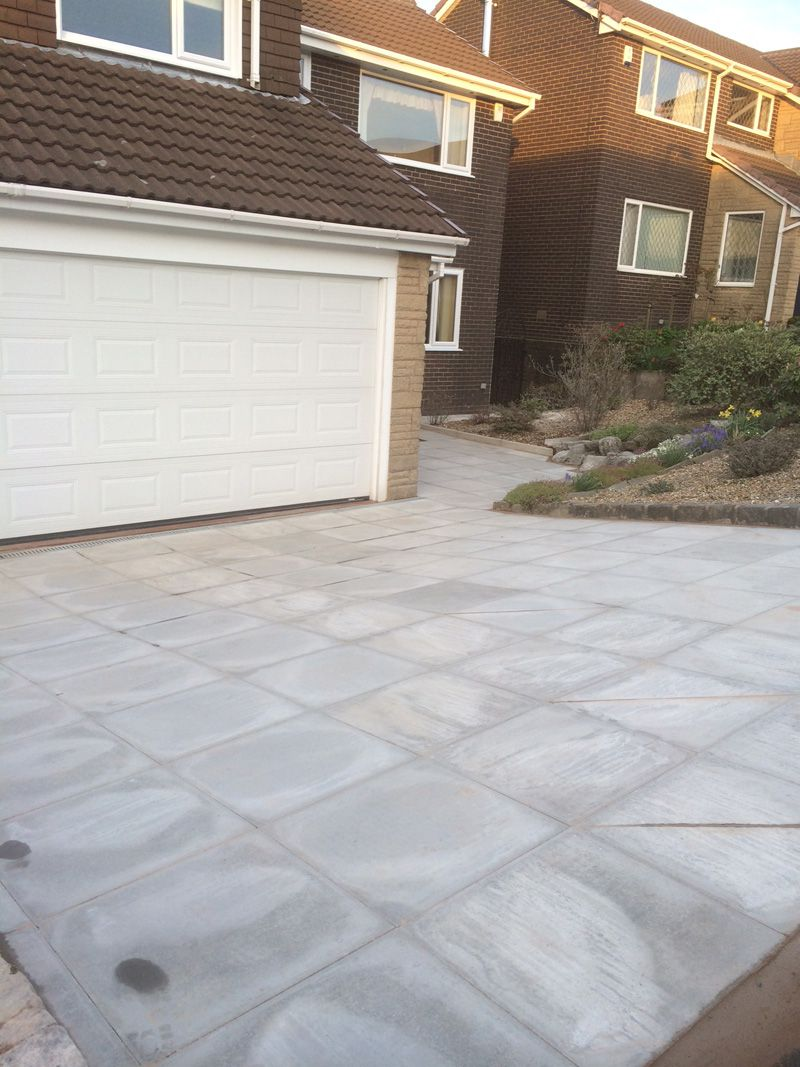 2x2 grey flags on drive way