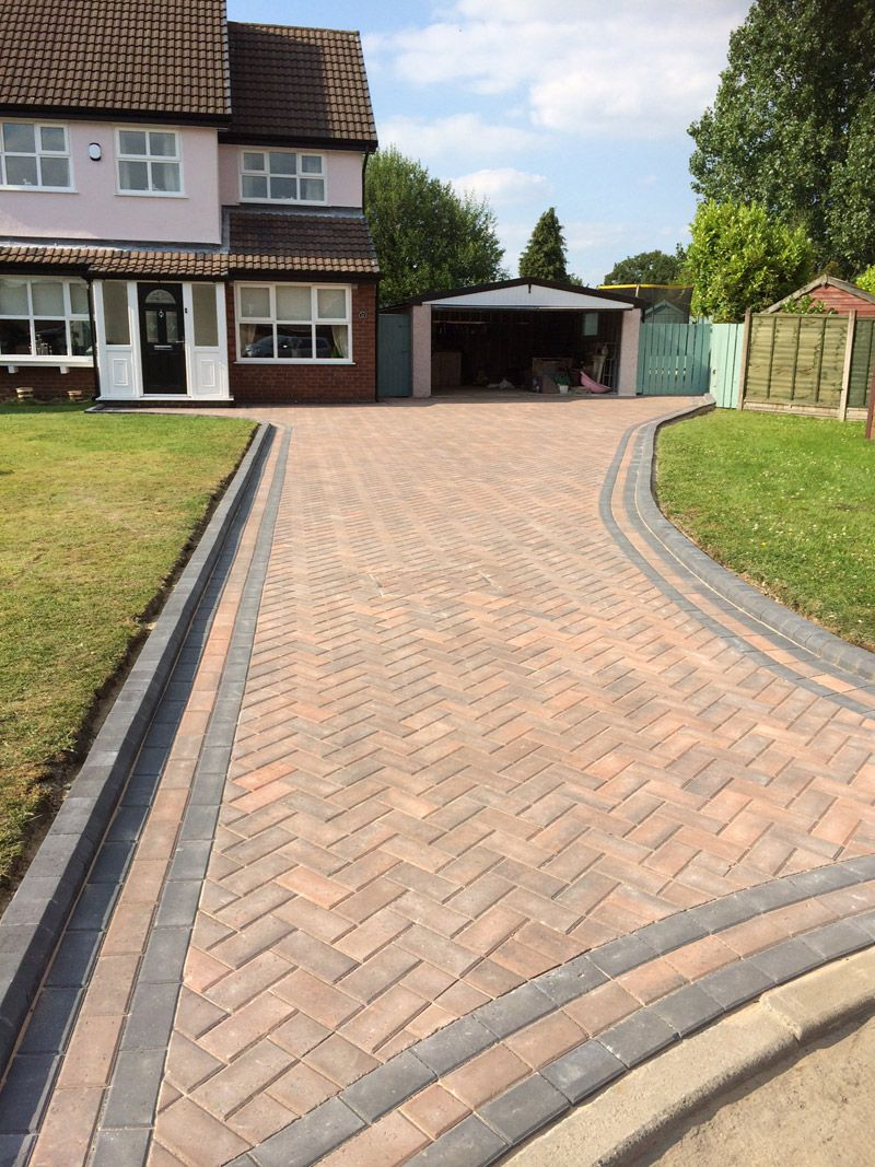 Rustic gold block paving with charcoal border