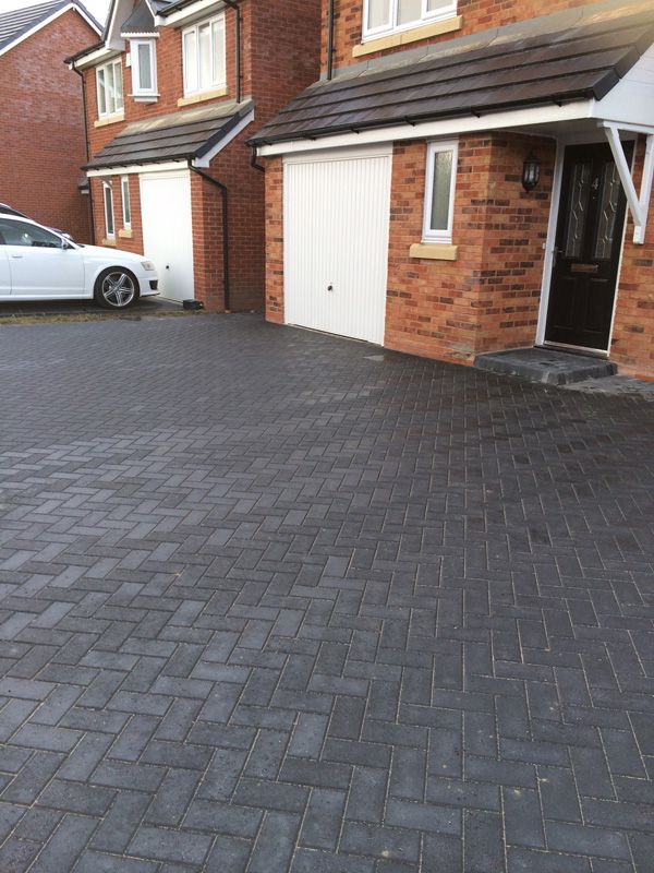 All charcoal block paving