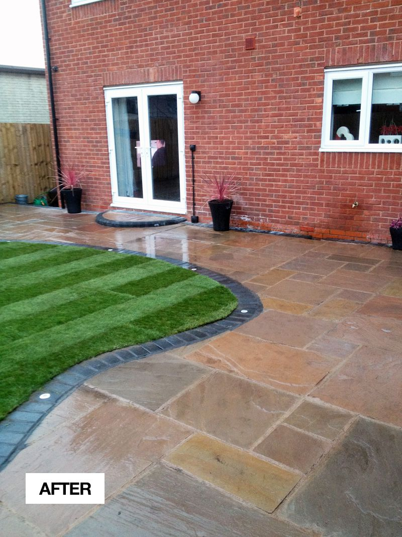 After - Autumn brown indian stone flags with charcoal block border also new lawn