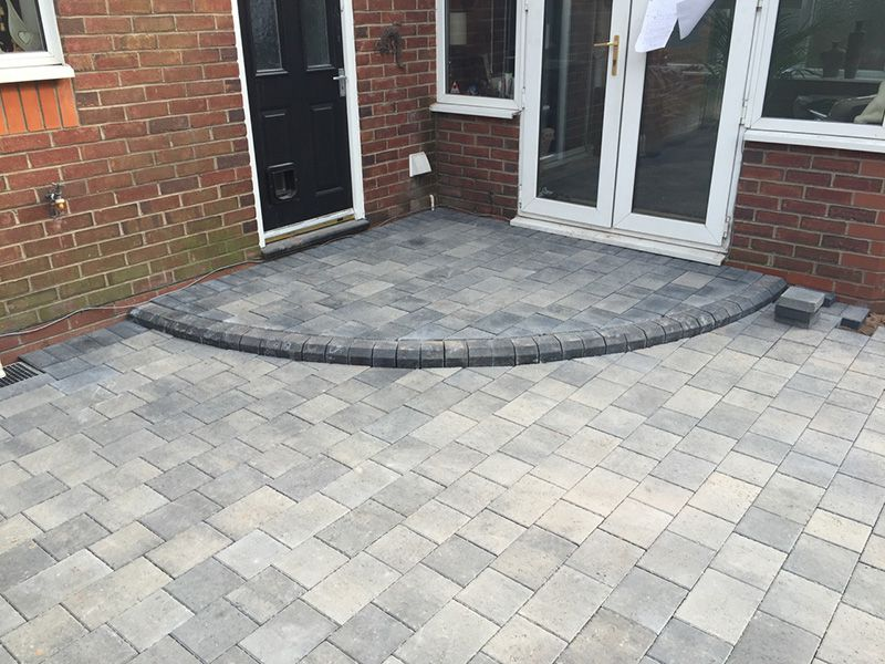 Madeira block paved patio with step Leigh.