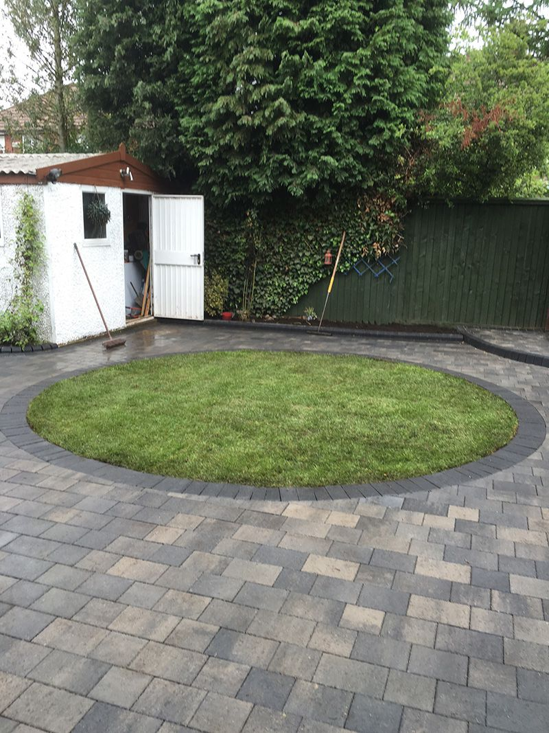 Block paved patio with turf circle Wigan.